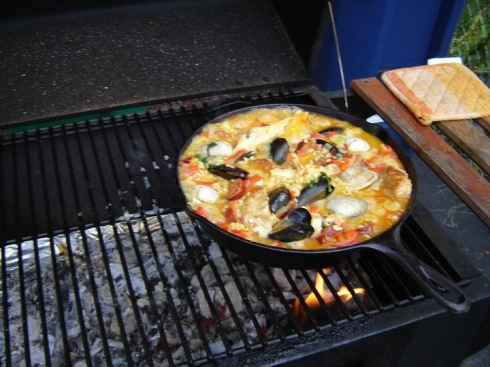 paella over a wood fire grill