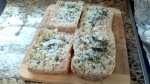 Easy recipe for focaccia style garlic bread with fresh rosemary, basil, garlic, olive oil and grated cheese from Paggi Pazzo.