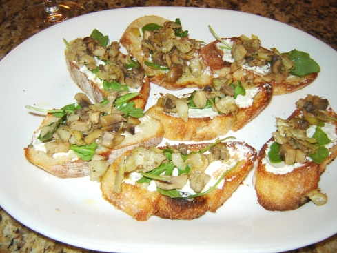 Spanish style crostini with artichoke, mushroom, goat cheese and arugula from Paggi Pazzo!