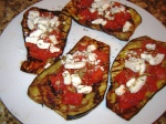 Grilled eggplant topped with a diced tomato sauce and goat cheese from Paggi Pazzo