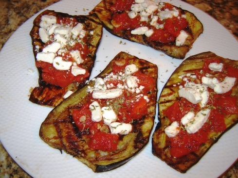 Grilled eggplant bruschetta style with diced tomato sauce, crumbled goat cheese and dried basil leaves from Paggi Pazzo