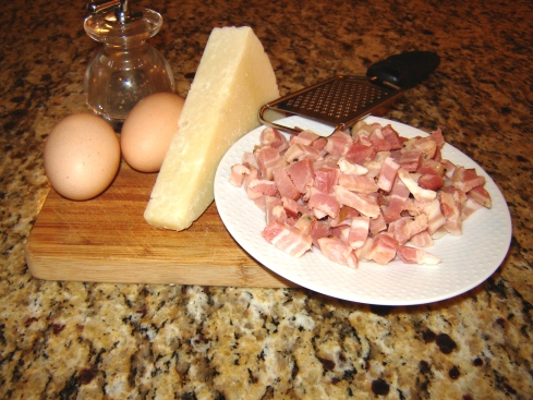 Authentic Roman Pasta alla Carbonara recipe ingredients including pancetta, Pecorino Romano, eggs, spaghetti, black pepper and olive oil from Paggi Pazzo