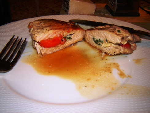 Stuffed pork with sliced cherry tomatoes, chunks of Pecorino Romano and spinach from Paggi Pazzo