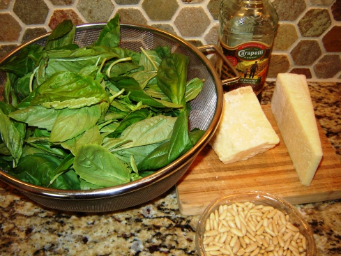 Preparing Pesto alla Genovese with basil, garlic, pine nuts, Pecorino Sardo and Reggiano Parmigiano from Paggi Pazzo