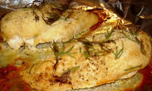 Grated Asiago baked over chicken breast fillets with fresh rosemary and crushed garlic Recipe from Paggi Pazzo