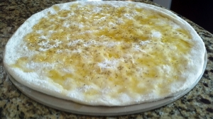 Preparing focaccia with fresh rosemary, garlic, and olive oil from Paggi Pazzo!