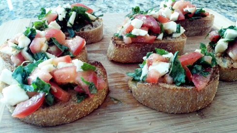 Classic ingredients make up this caprese style bruschetta with fresh mozzarella, roma tomatoes, fresh basil, garlic, olive oil, and ciabatta bread from Paggi Pazzo!