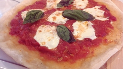Grilled authentic Napoletana pizza margherita recipe over a wood charcoal fire from Paggi Pazzo