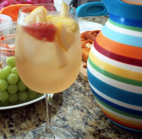 White wine sangria recipe with strawberries, grapes, lime, apple, pear, and Orvieto from Paggi Pazzo.