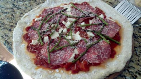 Inspired in Cinque Terre, this Ligurian style pizza recipe is made with soppressata, asparagus, and fresh mozzarella from Paggi Pazzo.