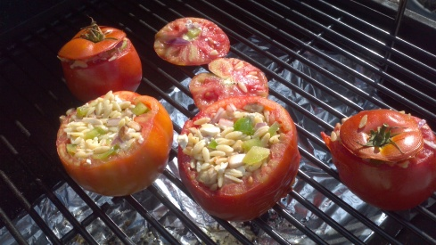 Grilled stuffed tomatoes with Feta cheese, orzo, peppers and onions from Paggi Pazzo