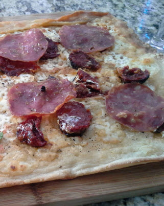 Roman Style Pizza Bianca with soppressata friuli, sun dried tomatoes, fontina, fresh mozzarella and oregano recipe from Paggi Pazzo