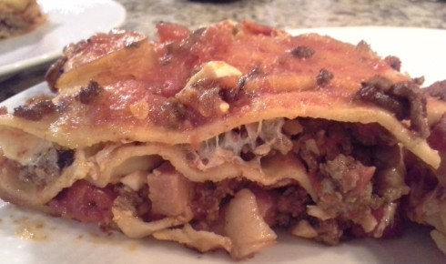 Lasagna alla Romana recipe with Chopped mortadella, pancetta, fresh Mozzarella, hard boiled eggs, ground beef, and crushed San Marzano tomatoes from Paggi Pazzo