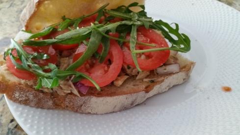 Italian style tuna panino recipe (panino al tonno) with sliced tomatoes and arugula from Paggi Pazzo