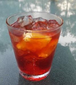 Negroni with St. George Botanivore gin, sweet Vermouth, Campari, club soda and orange peel from Paggi Pazzo