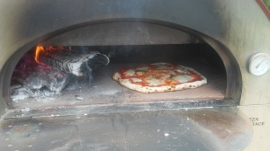 Authentic Napoli style pizza made from Molino Caputo Tipo 00 Pizza Flour, San Marzano peeled tomatoes, fresh mozzarella and fresh basil from Paggi Pazzo!